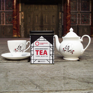 A tin of A MIdsummer Night's Dream tea with a fine china Hamlet themed teacup and teapot