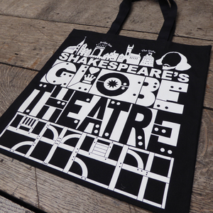 Black cotton bag with a bold, graphic print in white featuring title and details from Shakespeare's Globe theatre