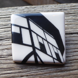 Asymmetric ceramic brooch with a  detail image of Shakespeare's Globe