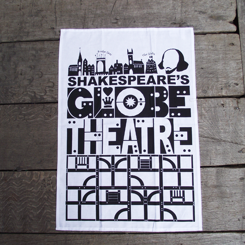 White cotton tea towel with a print in black celebrating Shakespeare's Globe. At the top of the design is a row of stylised silhouettes of some of the buildings of Tudor London and a silhouette portrait of Shakespeare. Beneath this are the words Globe Theatre made to look as if they are made from pegged timber. At the bottom of the tea towel are eight squares containing architecturally correct representations of timber and plaster panels making up the Globe Theatre.