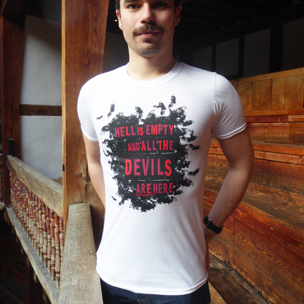 White cotton round-necked t-shirt with a print of a cloud of black bats on the chest. The bats surround a quote from Shakespeare play, The Tempest (Hell is empty and all the devils are here) which is printed in bold capital san serif letters in dark and bright reds. The Shakespeare's Globe logo is printed in black on the sleeve.