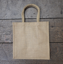 Reverse of a sturdy jute tote bag with a print showing a view of the Globe Theatre.