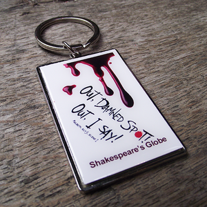 Chunky metal keyring with blood drips and  a quote from Lady Macbeth
