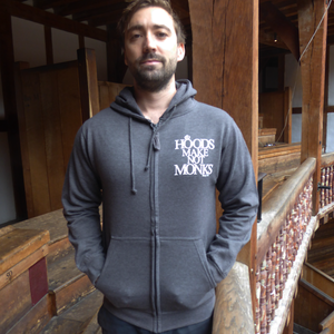 "Grey hooded sweatshirt with a full zip and a quote from Shakespeare's Henry VIII ""hoods make not monks"""