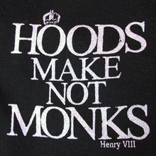 "Black hooded sweatshirt with a full zip and a quote from Shakespeare's Henry VIII ""hoods make not monks"""