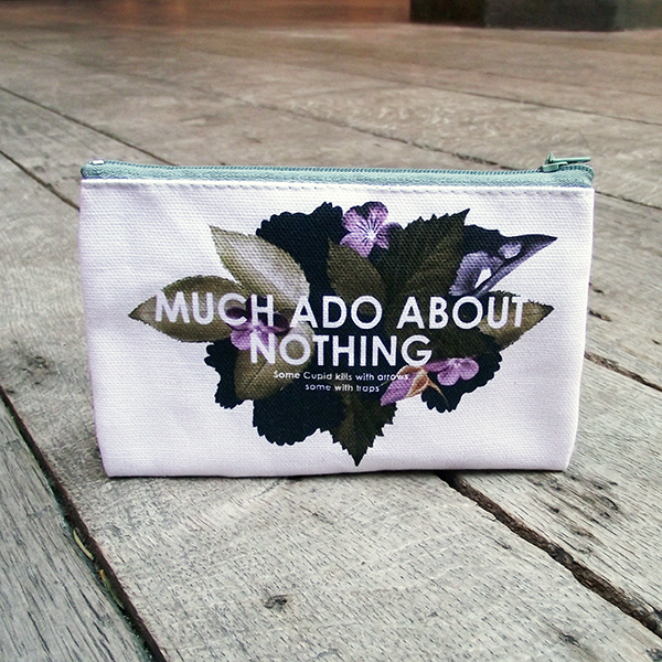 Cotton purse from Shakespeare's Globe with a floral design and a quote from Much Ado About Nothing
