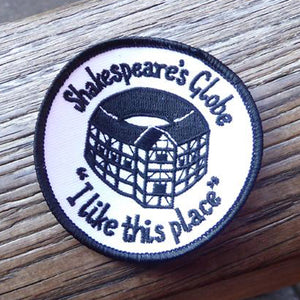 Iron-on patch embroidered with a black and white view of the Globe Theatre and a quote from Shakespeare play, As You Like It