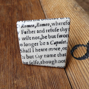 Asymmetric ceramic brooch with a snippet of Juliet's balcony speech from Shakespeare's Romeo and Juliet