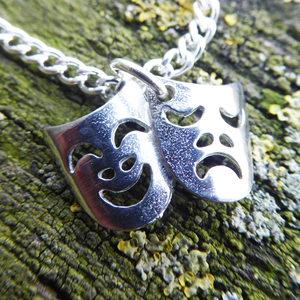 Pewter theatre masks pendant on a silver chain