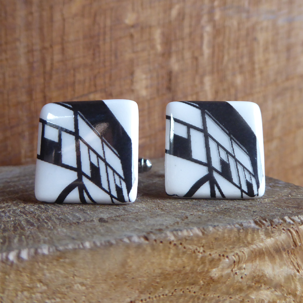 Ceramic cufflinks featuring  a black and white detail of the architecture of Shakespeare's Globe Theatre