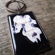 Chunky metal keyring with a smoke design and a quote from Romeo and Juliet