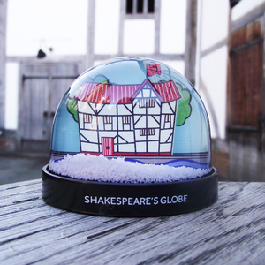 Snowglobe containing an illustration of Shakespeare's Globe Theatre on the River Thames.