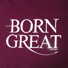 "Close up of wine red t-shirt with a quote from Shakespeare play, Twelfth Night. Quote reads ""Some are born great"""