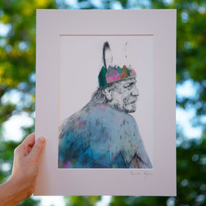 Illustration of the king from the Irish legend Liongseach. Mounted Print taken outside by Irish visual Artist Deirdre Byrne. The king´s face is drawn in pencil and the crown and cutouts are posca and gouache paper cutouts.