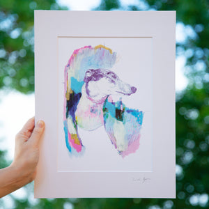 Print of an Illustration of a dog by Irish Visual Artist Deirdre. Photo of print taken outside