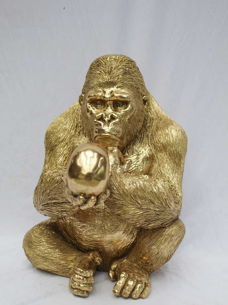 GOLD GORILLA WITH SKULL