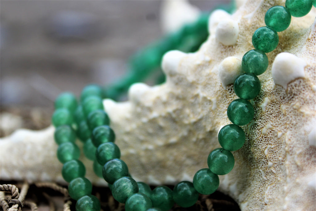 green aventurine, stone, mala beads, good luck, heart chakra, strength of heart