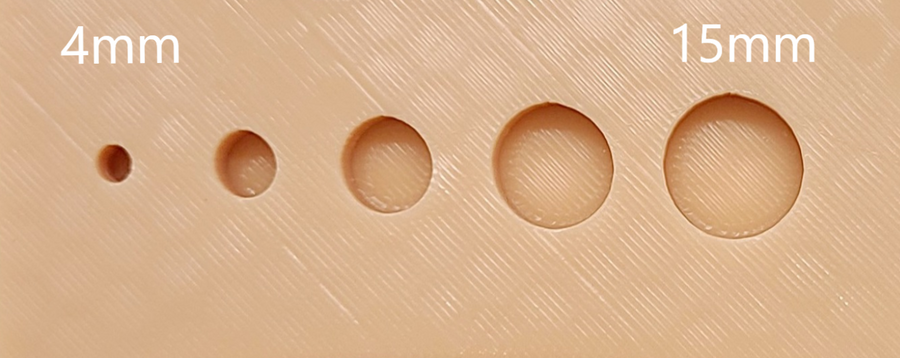 The Suture Buddy Pad with Port Holes.