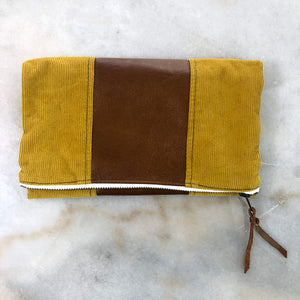 The Genuine Leather and Corduroy Fold Over Clutch // Romans 12:9