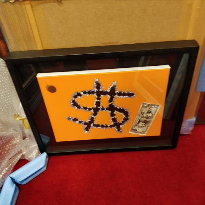 8. Orange dollar shot canvas with signed $1 bill (2014)