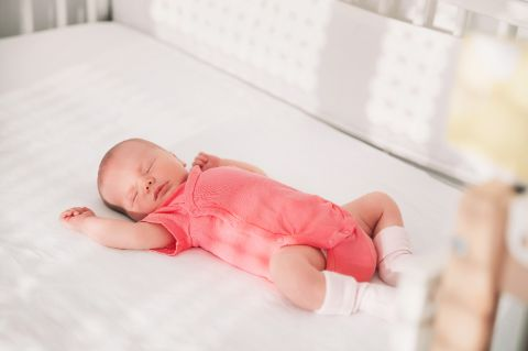 Baby sleeping safe and comfortable in a crib