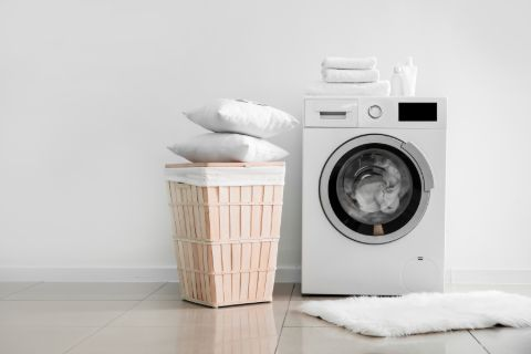 Pillows being machine washed to clean and extend their lifespan