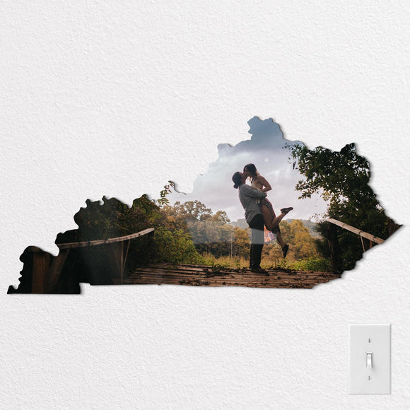 Couple kissing on Kentucky state shaped metal print, photo by Ariana Jordan