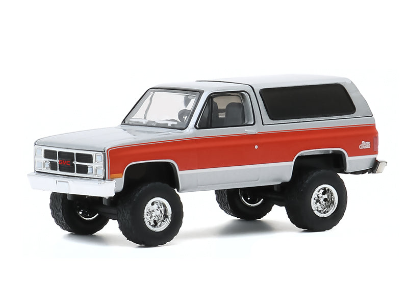 "1984 GMC Jimmy Sierra Classic (Lifted) Silver with Red Stripes ""All Terrain"" Series 10 Diecast 1:64 Model Car - Greenlight - 35170D"