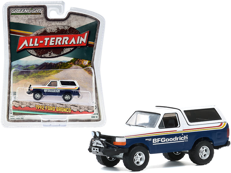 "1992 Ford Bronco with Off–Road Parts ""BFGoodrich Tires"" Blue and White with Stripes ""All Terrain"" Series 10 Diecast 1:64 Model Car - Greenlight - 35170E"