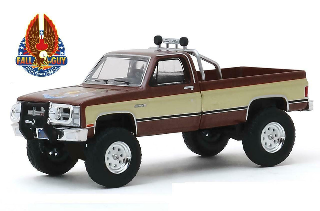 "1982 GMC K-2500 Pickup Truck Brown Metallic with Gold Stripes ""Fall Guy Stuntman Association"" ""The Fall Guy"" (1981-1986) TV Series ""Hollywood Series"" Release 26 Diecast 1:64 Model - Greenlight - 44860F"