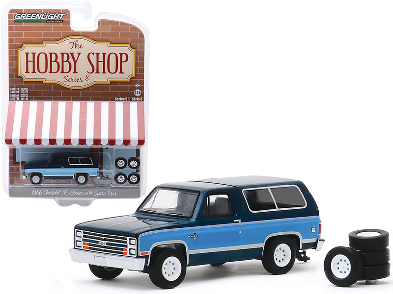 "1986 Chevrolet K5 Blazer Dark Blue Metallic and Light Blue and Spare Tires ""The Hobby Shop"" Series 8 Diecast 1:64 Model - Greenlight - 97080E"
