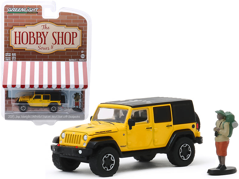 "2015 Jeep Wrangler Unlimited Rubicon Hard Rock Yellow with Black Top and Backpacker Figurine ""The Hobby Shop"" Series 8 Diecast 1:64 Model - Greenlight - 97080F"