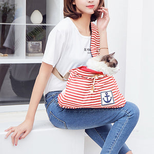 right sie of Qbleev striped dog sling red and white for puppy and cats carried by a girl