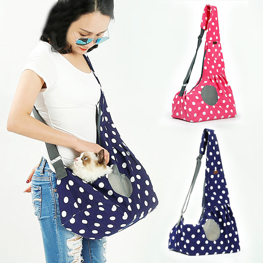 Qbleev wide strapped dog sling with wave points and ventilation mesh carried by a girl