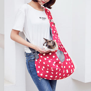 Qbleev wide strapped dog sling pink with wave points and ventilation mesh carried by a girl