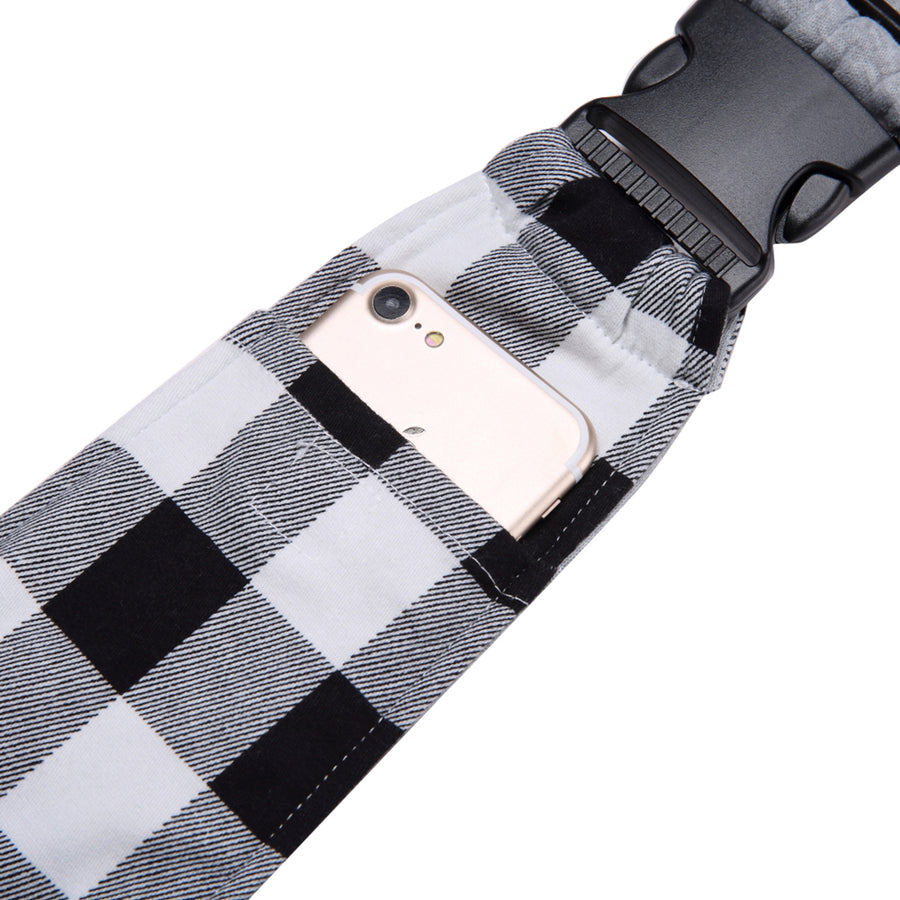 Qbleev soft canvas dog sling with pockets holding a phone