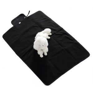 double folding dog mat QBLEEV with  a dog lying on