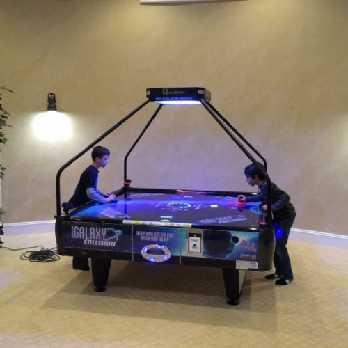 Close up of air hockey players