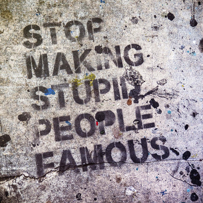 """Stop Making Stupid People Famous"" Street Graffiti Framed Print - Ustad Home"