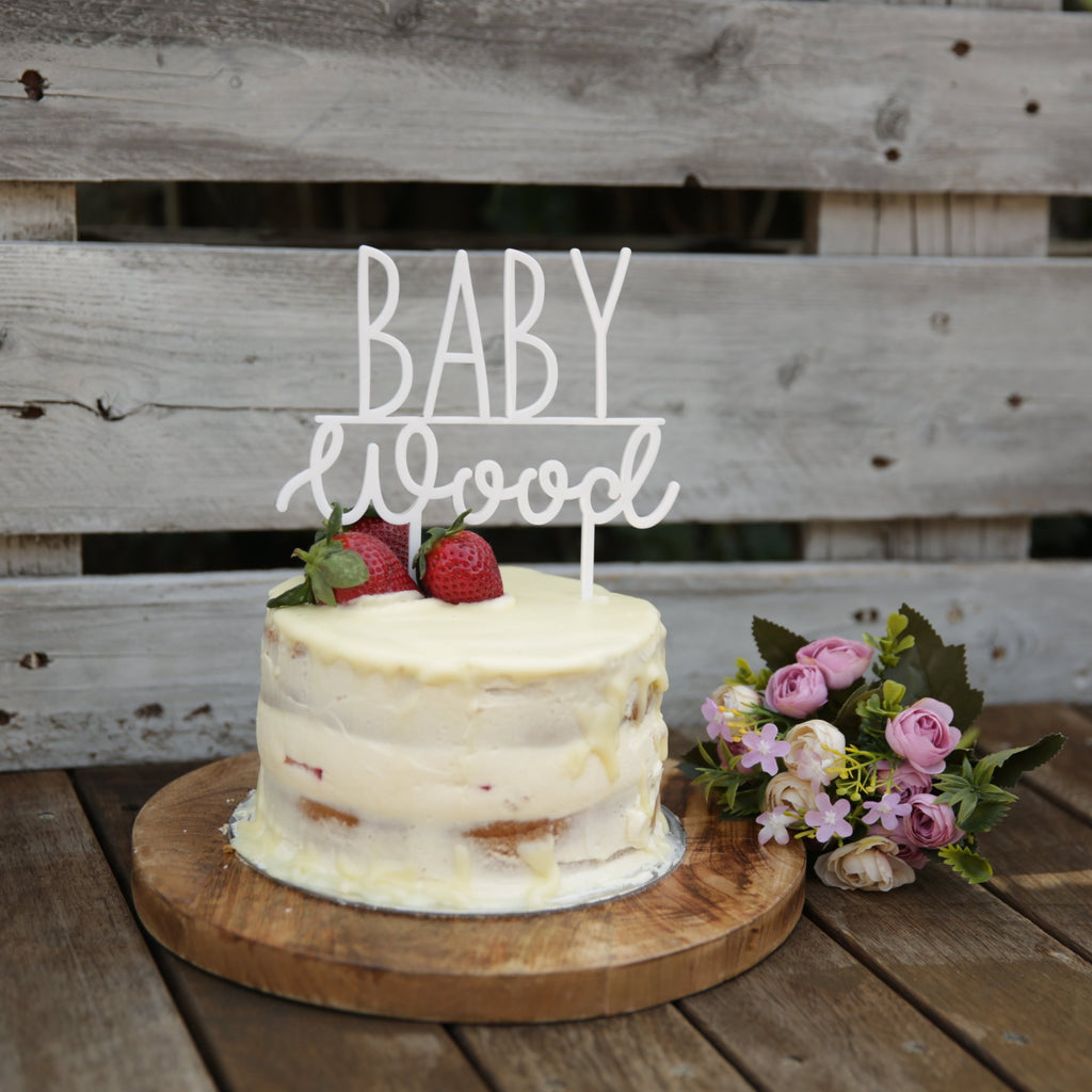 This cake topper is a perfect addition for your baby shower celebration and is customised with your name of choice. Choose from many coloured acrylics or bamboo ply. Your surname is set atop the word baby.