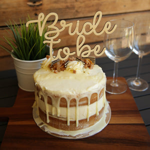 The beautiful cake topper can be in acrylic or bamboo ply. It has the text  Bride to Be in 2 tiers.