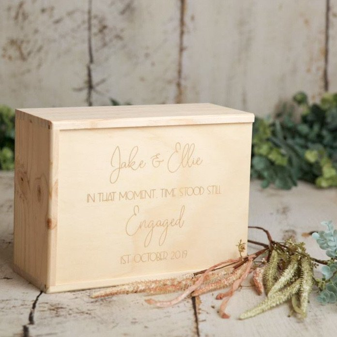 A lovely way to store the precious keepsakes from your engagement or a perfect gift for an engagement party. Featuring the couples name and engagement date laser engraved on the lid of the box.