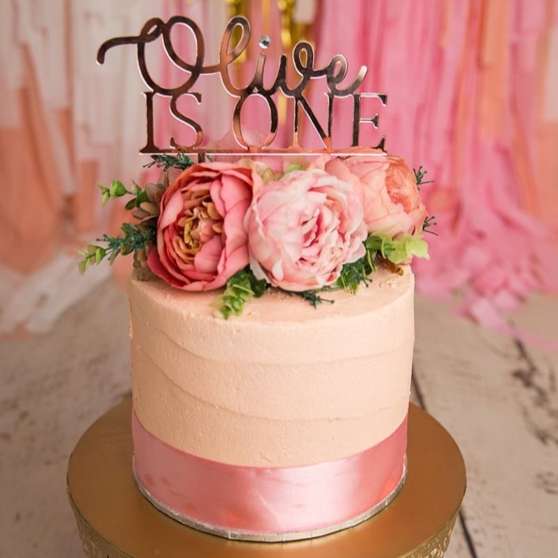 The 'IS ONE' Cake Topper is the perfect addition to a child's first birthday.  Choose bamboo or acrylic. The words Is One appear in upper case, below your child's name in a beautiful script font.