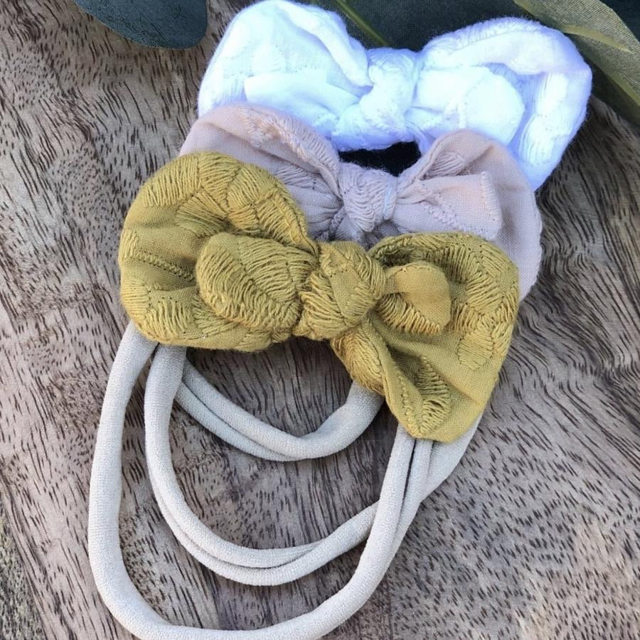 The Gracie Bow by Crybaby Boutique is a gorgeous double bow, on a stretchy nylon headband. Fits new baby through to toddler. Choose pink or white. These bows fit perfectly on our Bow Holder.