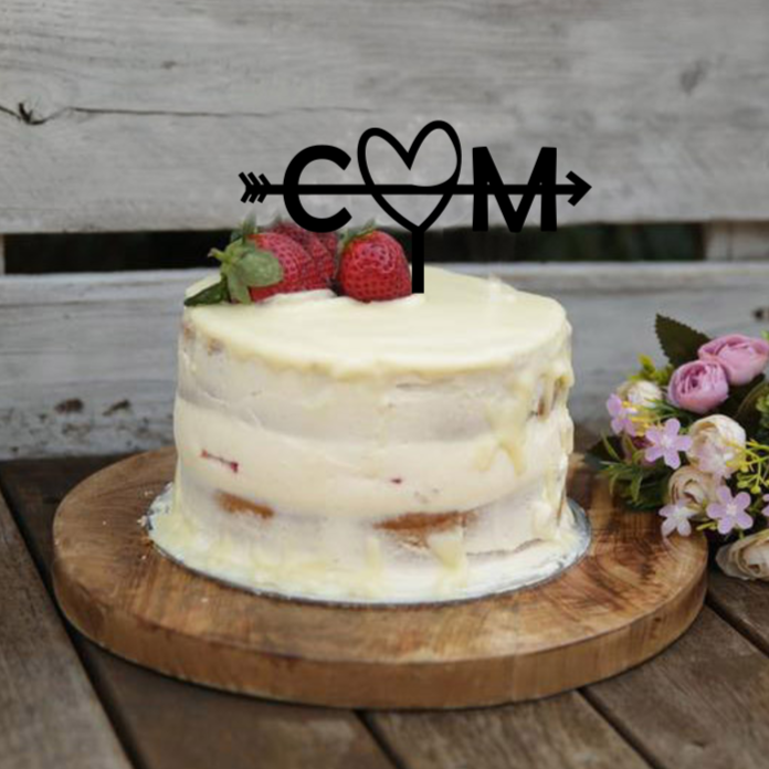 This cake topper is a perfect addition to your wedding or engagment celebration. Featuring your two initials between a heart. This topper is available in various coloured acrylics and bamboo ply.