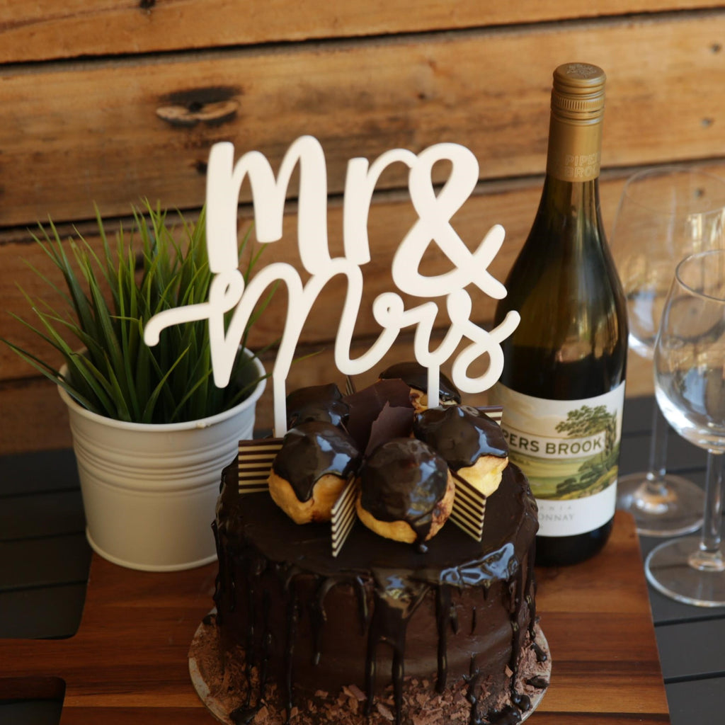 This gorgeous Wedding Cake Topper is the perfect addition to your Wedding Cake. Available in Acrylic or Bamboo, with the word Mr stacked on top of the word Mrs