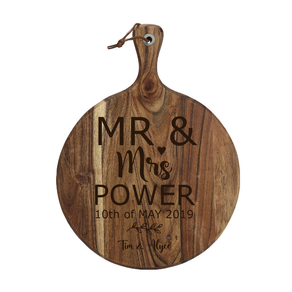 This beautiful laser engraved acacia wood serving board is a lovely Wedding Gift, New Home Gift or present for any reason. It is personalised with the surname and wedding date.