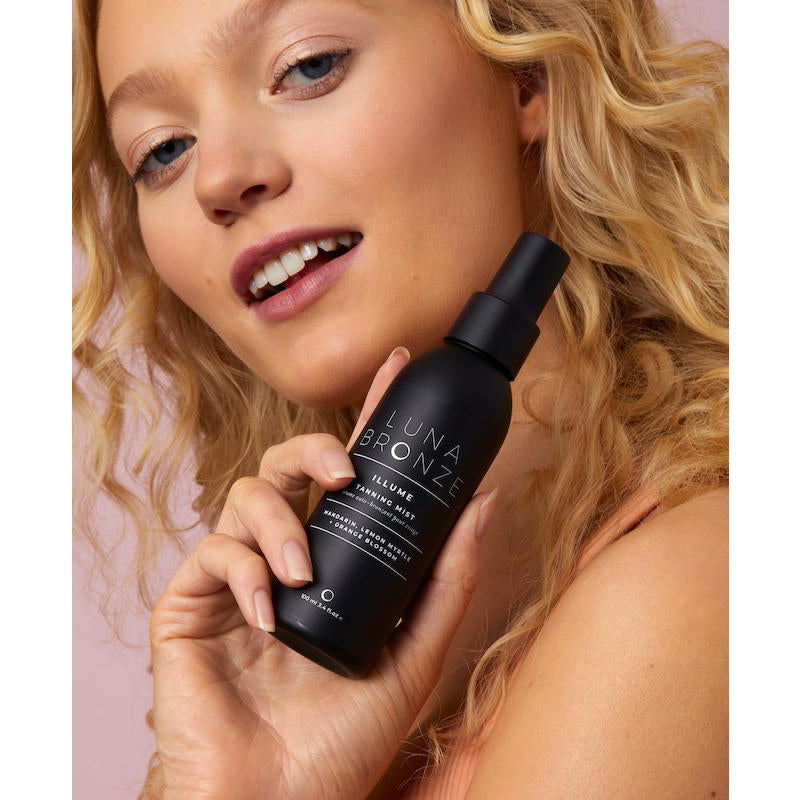 Luna Bronze Illume Tanning Mist in front of Model