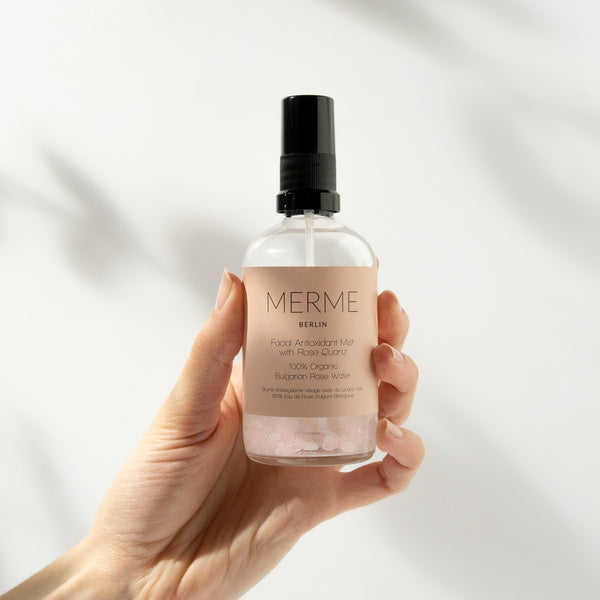 Merme Berlin Facial Antioxidant Mist With Rose Quartz 100% Organic Rosewater held in Hand
