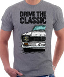 Drive The Classic Ford Escort M1 Round Headlights. T-shirt in Heather Grey Colour